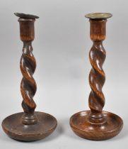 A Near Pair of Edwardian Oak Barley Twist Candle Sticks, 25cm high
