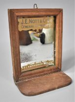 A Late Victorian/Edwardian Wall Hanging Advertising Mirror For J E Nott and Co Ltd General