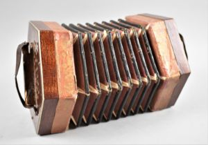 A Vintage Hexagonal Accordion with Ten Buttons, Some Requiring Attention