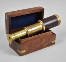 A Reproduction Miniature Leather Covered Brass Three Drawer Telescope