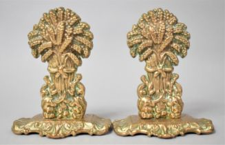 A Pair of Brass Wheatsheaf Fireside Ornaments, 16.5cms High