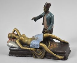 A Reproduction Cold Painted Bronze Figure Group Depicting Gent Beside Reclining Nude having Hinged