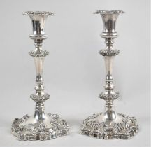 A Pair of Weighted Silver Plated Rococo Style Candlesticks, 25cms High