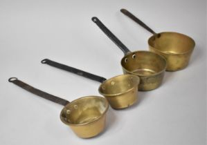 A Collection of Four Graduated Brass Saucepans with Iron Handles, The Largest 15cms Diameter