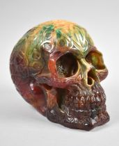 A Reproduction Resin Skull with Moulded Decoration