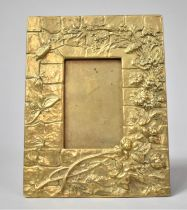 A Rectangular Brass Photo Frame Decorated in Relief with Flowers, Insects Etc, Easel Back, 17x13cms