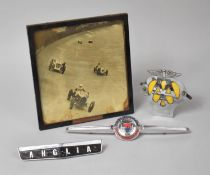 A Vintage AA Badge, Angular and Morris Car Badges and a Photograph of Vintage Racing Cars