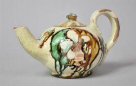 An Early Terracotta Sancai Glazed Teapot, 9.5cm high