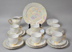 A Gilt and Pearlware Tea Set to comprise Six Cups, Five Saucers and Eleven Side Plates
