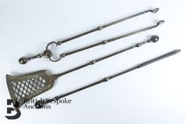 A Set of Heavy Cast-Metal Fire Irons