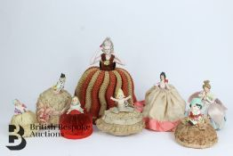 Eight Porcelain Miniature Dolls