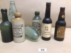 A QUANTITY OF GLASS AND STONEWARE ADVERTISING BOTTLES WITH A FULL BOTTLE OF OLD FART ALE AND