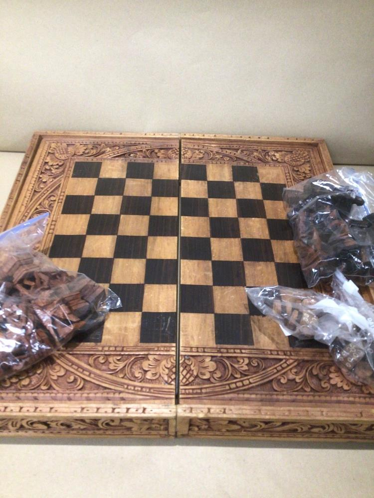 A VINTAGE DECORATIVE CARVED WOOD SUITCASE CHESS AND BACKGAMMON GAME SET - Image 2 of 3