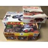 THREE BOXED REMOTE CONTROL TOYS, THUNDER SHOT BY TAMIYA, FORD ESCORT XR3 BY TAIYO, AND R.A.T.S BY