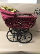 AN EARLY CHILDS TOY PRAM MADE FROM WICKER WITH CAST IRON WHEELS