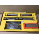 A VINTAGE TRIANG RHX ELECTRIC MODEL RAILROAD, WITH TRACKS CARRIAGES AND A HORNBY BOX, MISSING