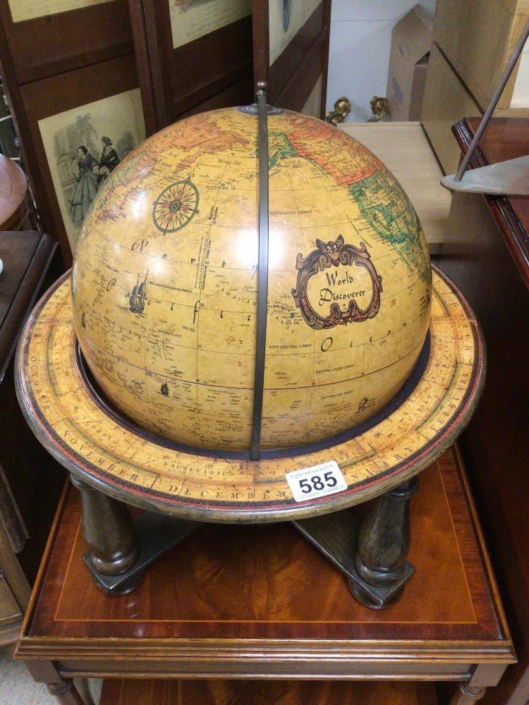 A TABLE TOP WORLD DISCOVERER WOODEN FRAMED GLOBE, 46CM HIGH