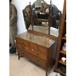 A VINTAGE OAK TWO OVER TWO DRESSING TABLE WITH TRIPLE MIRROR