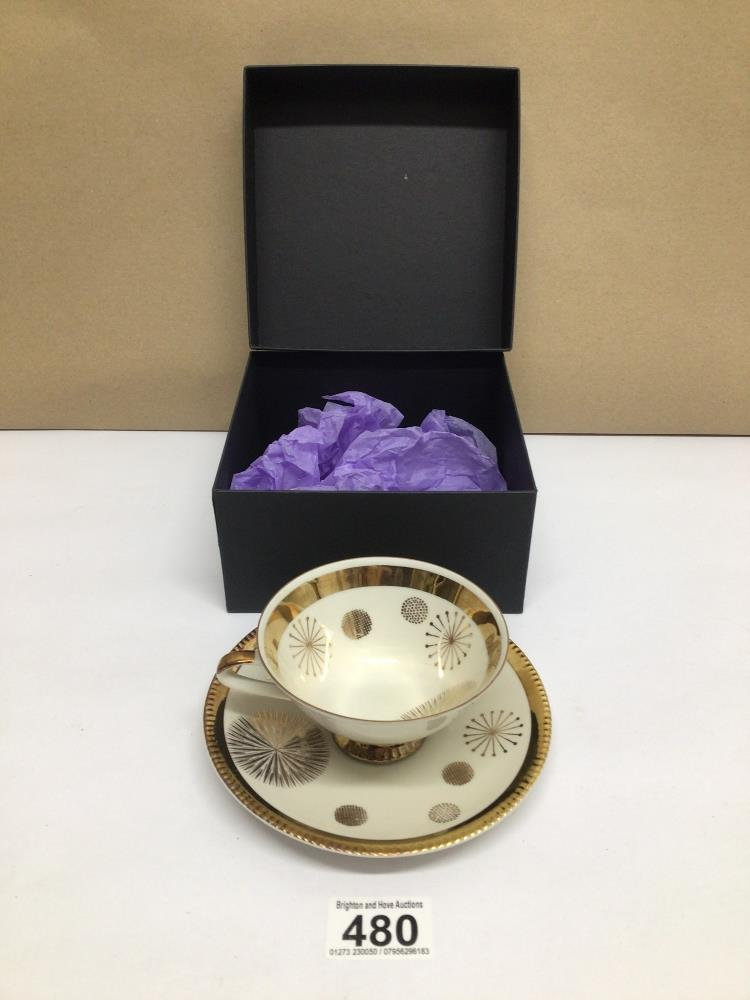 A BAVARIAN DUO TEA CUP AND SAUCER