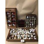 A LARGE COLLECTION OF MOSTLY PORCELAIN THIMBLES, INCLUDES ROYAL CROWN DERBY, BIRCHCROFT, AND MORE
