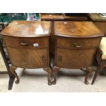 A PAIR OF VINTAGE BEDSIDE CHESTS ON CABROILE LEGS