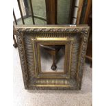 AN EARLY GILDED PICTURE FRAME, 47 X 53CM