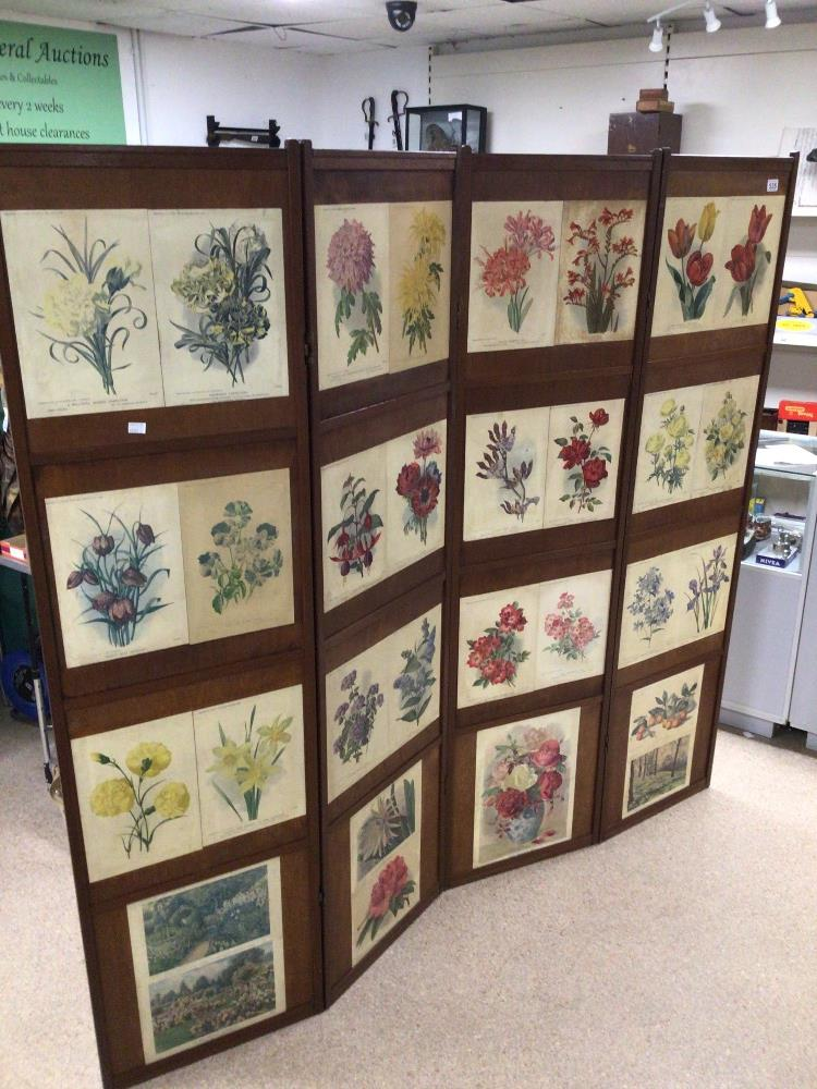 A VINTAGE WOODEN FOUR FOLD SCREEN DECORATED WITH VICTORIAN FLOWER PRINTS/ AND VICTORIAN DRESSWEAR