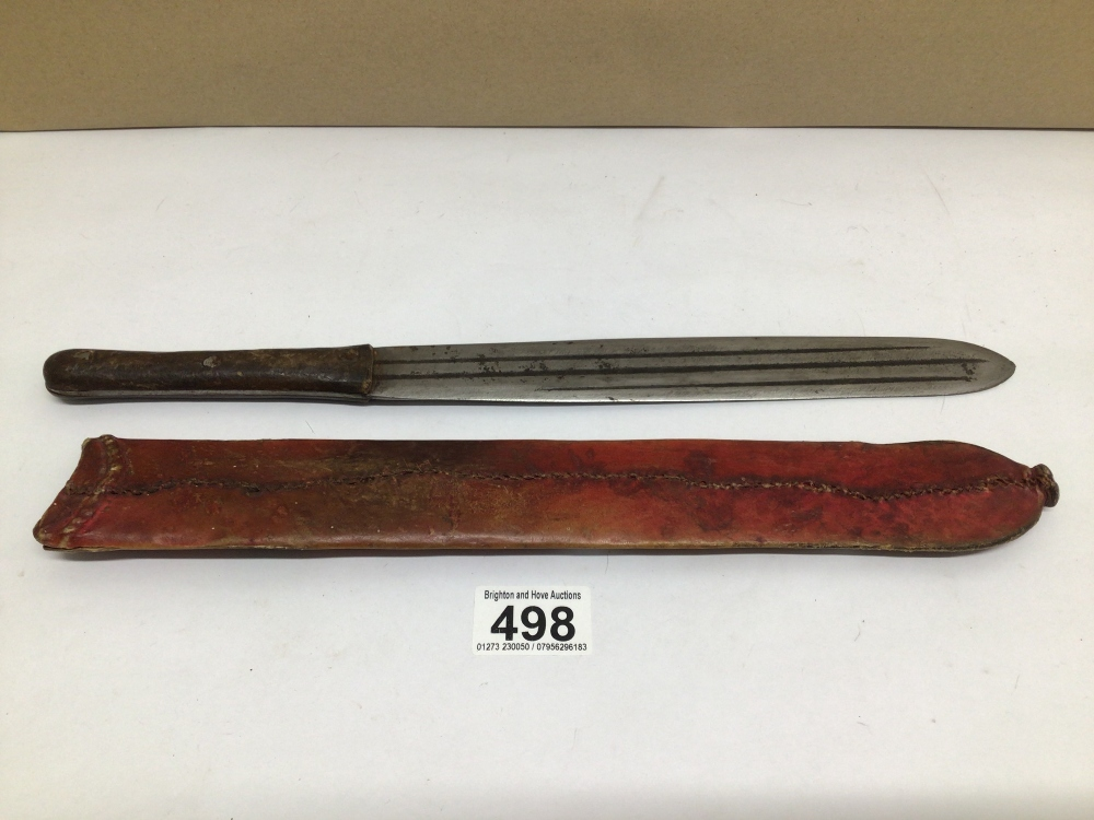 AN EARLY LEATHER HANDLE MACHETE WITH LEATHER SHEATH