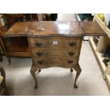 A VINTAGE CAMEO FURNITURE SERPENTINE FRONTED THREE DRAWER CHEST WITH EXTENDING LEAVES TO THE