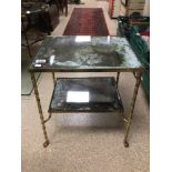A HEAVY REGENCY TWO TIER TABLE ORNATE BRASS LEGS WITH CLAW FEET MERCURY GLASS TOPS (RESILVERING REQ)