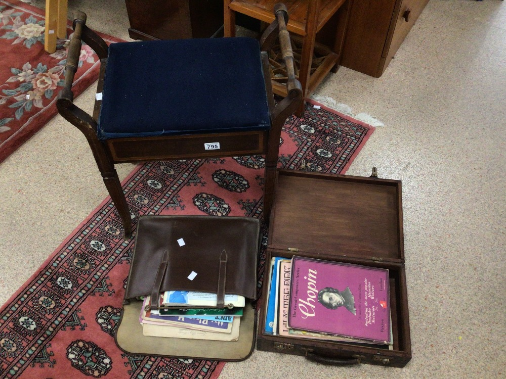 A VINTAGE PIANO STOOL WITH STORAGE AND A QUANTITY OF MUSIC SHEETS