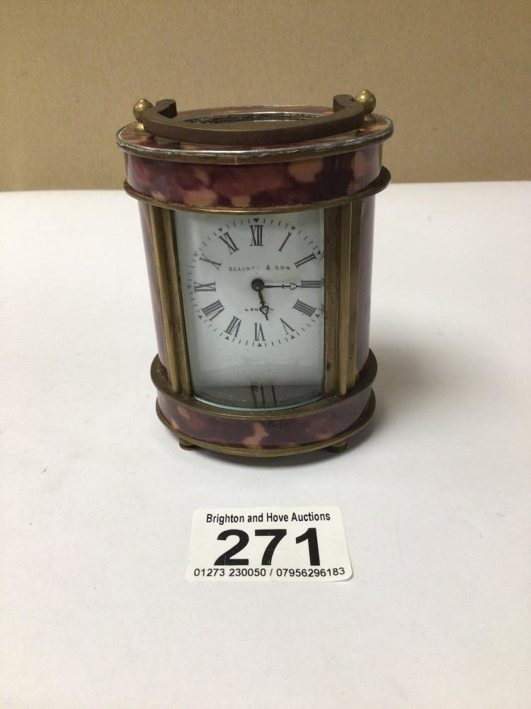 A SMALL BRASS WITH SIMULATED TORTOISESHELL OVAL CARRIAGE CLOCK, ELLIOT AND SONS ROMAN NUMERALS TO