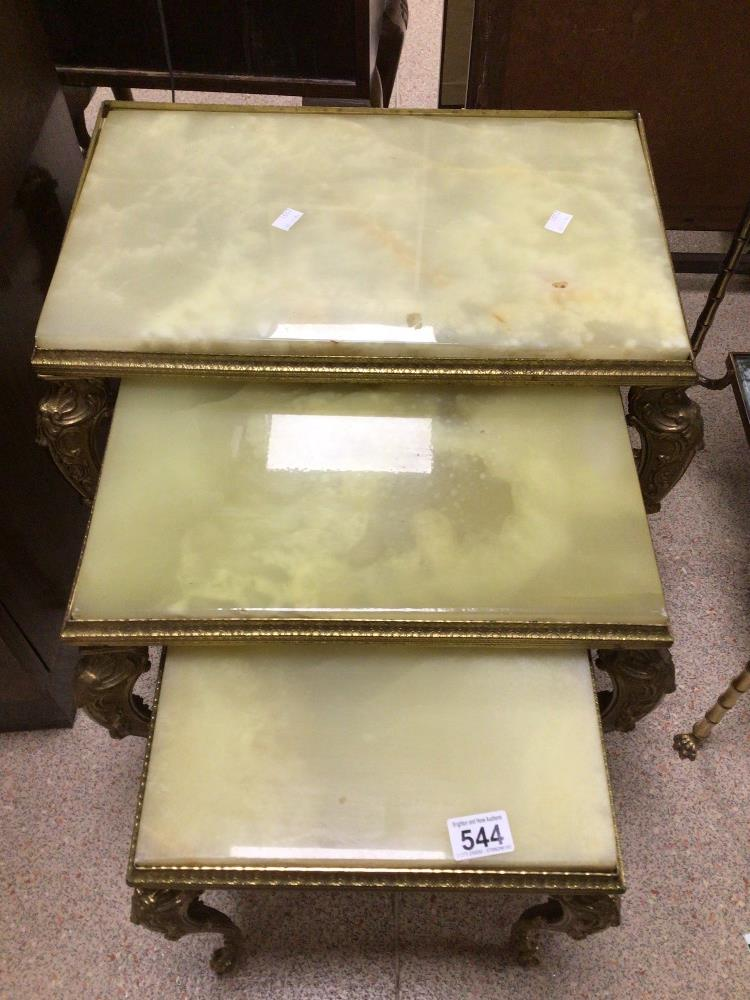 A VINTAGE NEST OF THREE TABLES GILDED FRAMES AND ONYX TOPS
