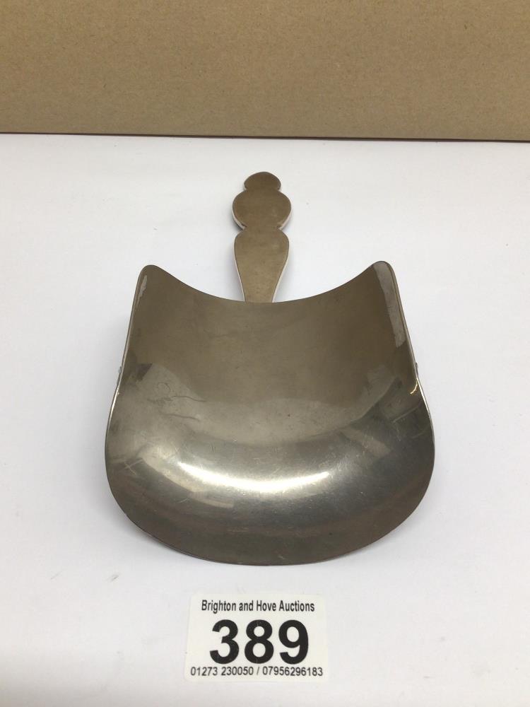 A METAL JOCKEYS SHOE HORN