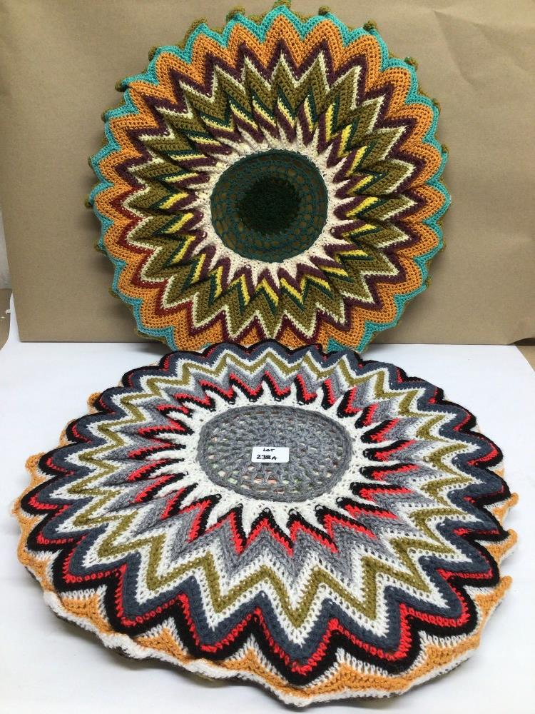 A PAIR OF VINTAGE 1970S RETRO/BOHO ROUND CROCHETED CUSHIONS, 50CM DIAMETER WITH A SIMILAR TABLE MAT