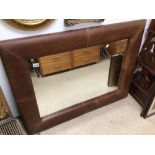 A LARGE LEATHER FRAMED MIRROR, 118 X 91CM