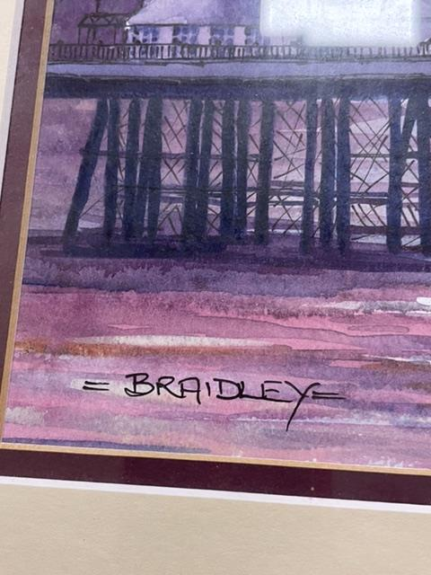 BRADLEY TWO SIGNED FRAMED AND GLAZED WATERCOLOURS BY LOCAL ARTIST, (BRIGHTON PIER AND AFTER THE