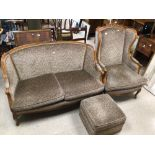 A MODERN TWO SEATER SOFA WITH A MATCHING WINGBACK CHAIR AND STOOL