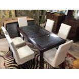 A MODERN MANGO WOODEN DINING TABLE WITH THREE FRETWORK SLOTS WITH GLASS PROTECTION ALSO SIX MODERN