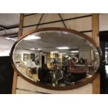 AN ART NOUVEAU OVAL COPPER MIRROR WITH BEVELLED GLASS A/F, 71 X 42CM