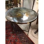 A HEAVY REGENCY ROUND TABLE WITH ORNATE LEGS AND CLAW FEET, MERCURY GLASS TOP NEEDS (RE-SILVERING)