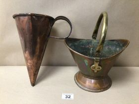 A VINTAGE COPPER POURER WITH A SMALL COPPER BUCKET WITH BRASS HANDLE