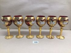 A SET OF SIX MURANO STYLED RUBY RED GILDED AND ENAMELED WINE GLASSES