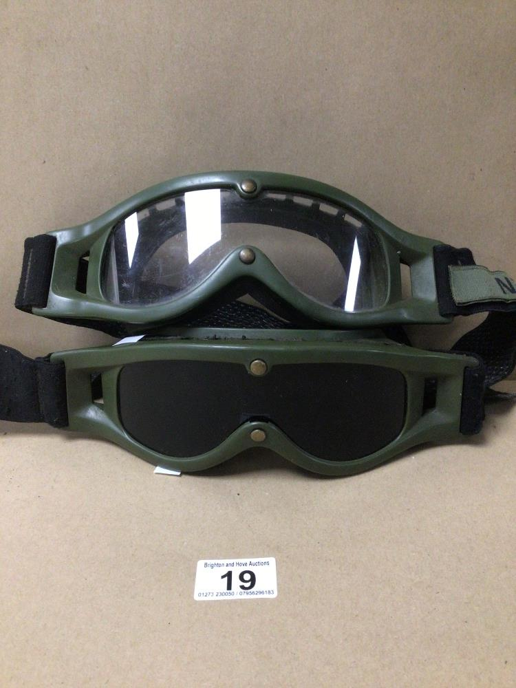 TWO PAIRS OF DUTCH ARMY MVD BALLISTIC GOGGLES, WITH SERVICE NAME TAGS. ONE PAIR CLEAR AND THE