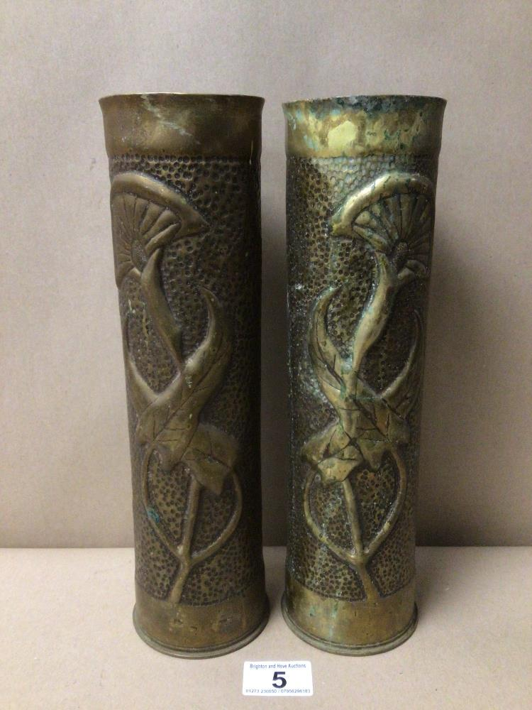 A MATCHING PAIR OF 75MM WWI FRENCH FIELD GUN TRENCH ART BRASS SHELL CASINGS FORMED INTO VASES,