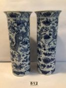 A PAIR OF CHINESE KANGXI BLUE AND WHITE SPILL VASES WITH SCROLLING DRAGONS AMIDST FLOWERING BLOOMS