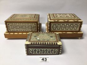 TWO VINTAGE CIGARETTE BOXES ONE BEING MUSICAL ALONG WITH ONE OTHER INLAY BOX