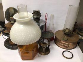 A QUANTITY OF VINTAGE OIL LAMPS INCLUDES A COPPER P. J BRYANT OF BRISTOL