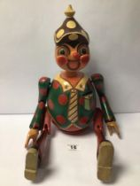 A VINTAGE WOODEN PINOCCHIO FIGURE WITH REMOVABLE ARMS AND LEGS