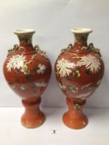 A PAIR OF LARGE EARLY 20TH CENTURY SATSUMA VASES PAINTED CHRYSANTHEMUMS ON IRON RED GROUND, 41CM
